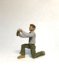 O Scale Man on Knee with Wrench